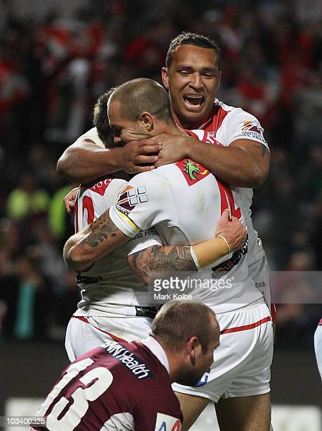 Nathan Fien Matt Cooper and Neville Costigan of the Dragons celebrate after Fien scored a try during the round 23 NRL match between the St George...