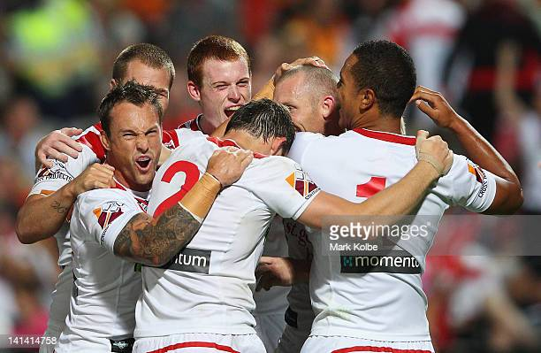 Nathan Fien of the Dragons congratulates Ben Hornby of the Dragons as celebrates with his team mates after scoring a try during the round three NRL...