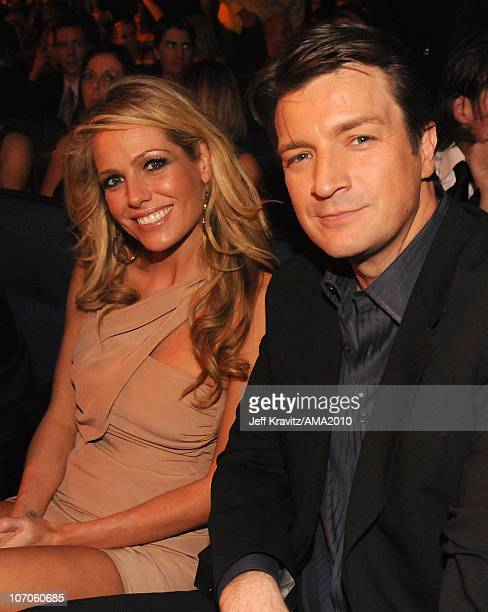 Nathan Fillion and guest post at the 2010 American Music Awards at Nokia Theatre LA Live on November 21 2010 in Los Angeles California