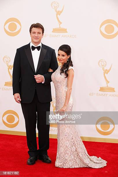 Nathan Fillion and Mikaela Hoover on the Red Carpet for the 65th Primetime Emmy Awards  which will be broadcast live across the country 8001100 PM...