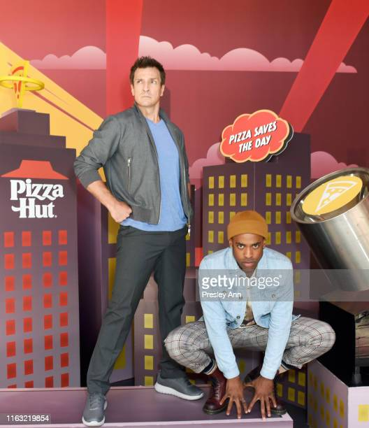 Nathan Fillion and Titus Makin Jr of 'The Rookie' attend the Pizza Hut Lounge at 2019 ComicCon International San Diego on July 20 2019 in San Diego...