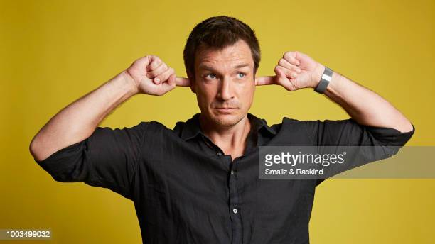 Nathan Fillion from ABC's 'The Rookie' poses for a portrait at the Getty Images Portrait Studio powered by Pizza Hut at San Diego 2018 Comic Con at...