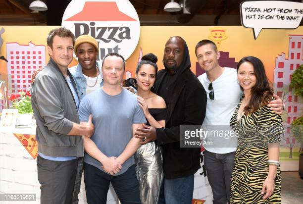 Nathan Fillion Titus Makin Jr Alexi Hawley Alyssa Diaz Richard T Jones Eric Winter and Melissa O'Neil of 'The Rookie' attend the Pizza Hut Lounge at...