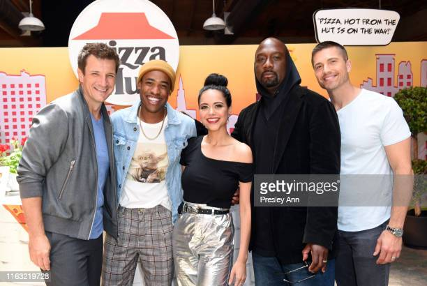 Nathan Fillion Titus Makin Jr Alyssa Diaz Richard T Jones and Eric Winter of 'The Rookie' attend the Pizza Hut Lounge at 2019 ComicCon International...