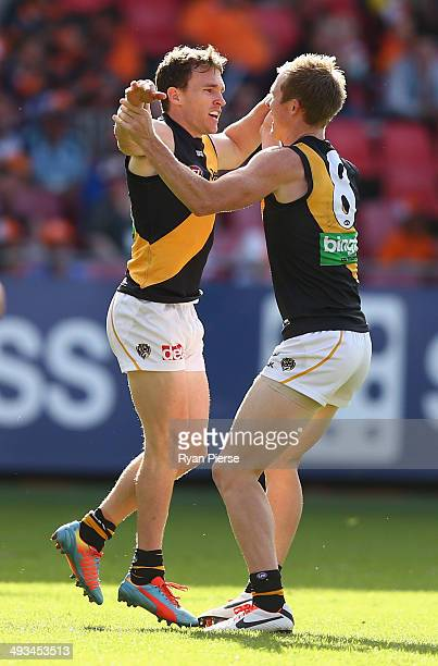 Nathan Foley of the Tigers celebrates a goal during the round 10 AFL match between the Greater Western Sydney Giants and the Richmond Tigers at...
