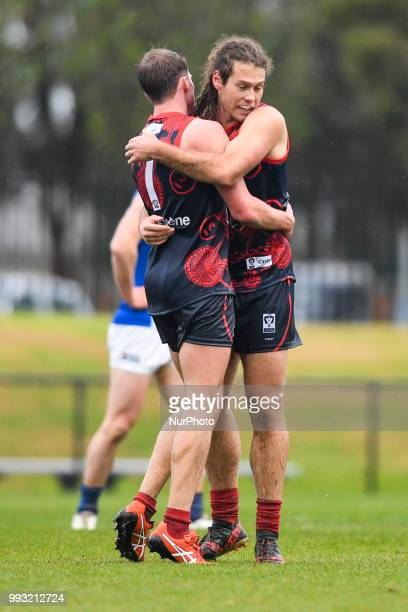 Nathan Foote and Jack Hutchins of the Casey Demons celebrate a goal during the VFL round 14 game between the Casey Demons and North Melbourne at...
