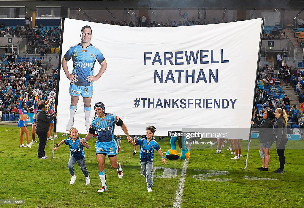 Nathan Friend of the Titans runs onto the field for his last home game of the season before his retirement during the round 25 NRL match between the Gold Coast Titans and the Penrith Panthers at Cbus Super Stadium on August 27, 2016 in Gold Coast, Australia.