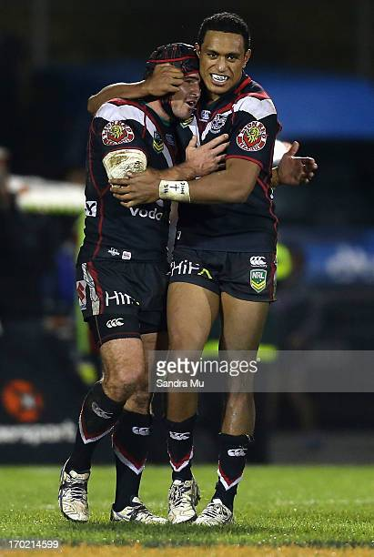 Nathan Friend of the Warriors and Glen Fisiiahi of the Warriors celebrate their win during the round 13 NRL match between the New Zealand Warriors...