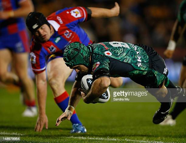 Nathan Friend of the Warriors dives over the try line to score during the round 20 NRL match between the Warriors and the Newcastle Knights at Mt...