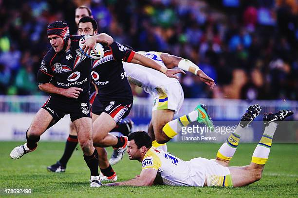 Nathan Friend of the Warriors makes a break during the round 16 NRL match between the New Zealand Warriors and the Canberra Raiders at Mt Smart...