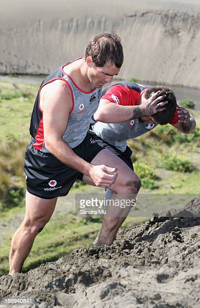 Nathan Friend of the Warriors trains on the sand dunes during the New Zealand Warriors NRL training session at Bethells Beach on November 10 2012 in...