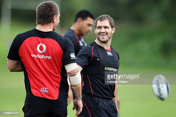 Nathan Friend shares a joke with Jacob Lillyman during a New Zealand Warriors NRL training session at Otahuhu College on April 30 2012 in Auckland...
