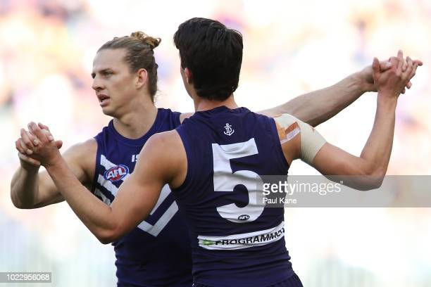 Nathan Fyfe and Adam Cerra of the Dockers celebrate a goal during the round 23 AFL match between the Fremantle Dockers and the Collingwood Magpies at...