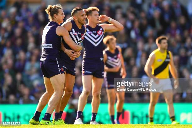 Nathan Fyfe and Harley Bennell of the Dockers celebrates a goal during the 2017 AFL round 22 match between the Fremantle Dockers and the Richmond...
