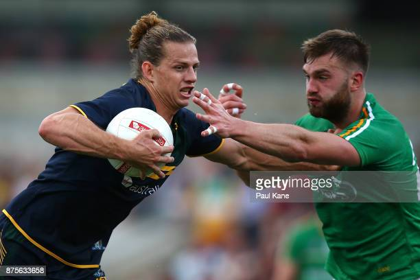 Nathan Fyfe of Australia fends off a tackle by Aidan O'Shea of Ireland during game two of the International Rules Series between Australia and...