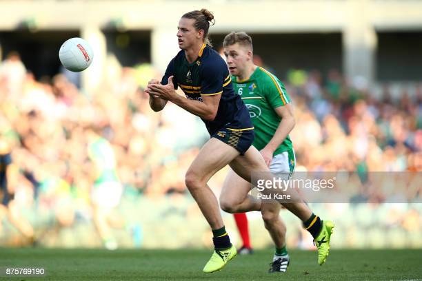 Nathan Fyfe of Australia hand passes the ball during game two of the International Rules Series between Australia and Ireland at Domain Stadium on...