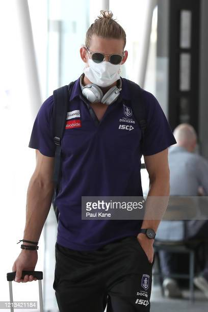 Nathan Fyfe of the Dockers arrives with team mates at Perth airport prior to their flight to Melbourne for their opening game of the 2020 Season, at...