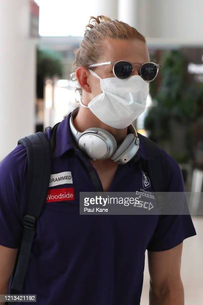 Nathan Fyfe of the Dockers arrives with team mates at Perth airport prior to their flight to Melbourne for their opening game of the 2020 Season at...