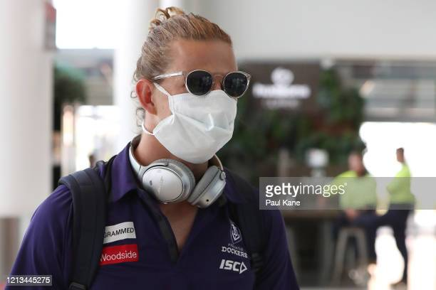 Nathan Fyfe of the Dockers arrives with team mates at Perth airport prior to the flight to Melbourne for their opening game of the 2020 Season, at...