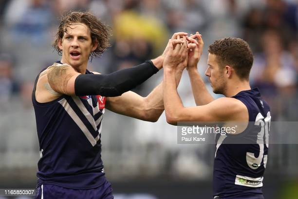 Nathan Fyfe of the Dockers celebrates a goal during the round 20 AFL match between the Fremantle Dockers and the Geelong Cats at Optus Stadium on...