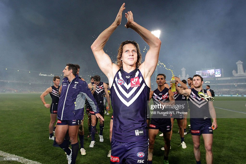Nathan Fyfe of the Dockers celebrates after winning and playing his 100th game during the round eight AFL match between the Fremantle Dockers and the North Melbourne Kangaroos at Domain Stadium on May 23, 2015 in Perth, Australia.