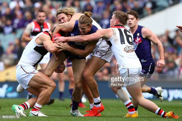 Nathan Fyfe of the Dockers contests for the ball against Luke Dunstan Sam Gilbert and Jack Newnes of the Saints during the round 15 AFL match between...