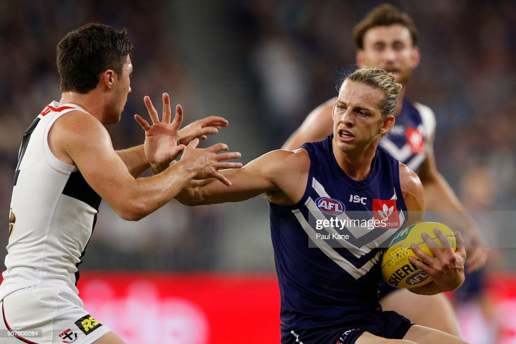Nathan Fyfe of the Dockers fends off Jade Gresham of the Saints during the round eight AFL match between the Fremantle Dockers and the St Kilda Saints at Optus Stadium on May 12, 2018 in Perth, Australia.