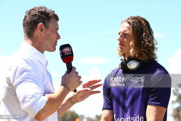Nathan Fyfe of the Dockers is interviewed pregame by television commentator Cameron Mooney the JLT Community Series AFL match between the West Coast...