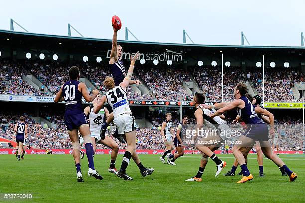 Nathan Fyfe of the Dockers leaps above the pack to tap the ball outduring the round five AFL match between the Fremantle Dockers and the Carlton...