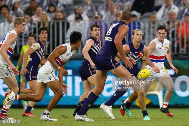 Nathan Fyfe of the Dockers looks to handball during the round five AFL match between the Fremantle Dockers and the Western Bulldogs at Optus Stadium...