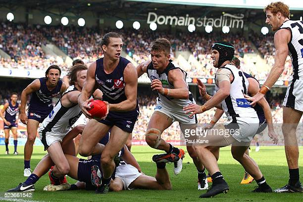 Nathan Fyfe of the Dockers looks to pass the ball during the round five AFL match between the Fremantle Dockers and the Carlton Blues at Domain...