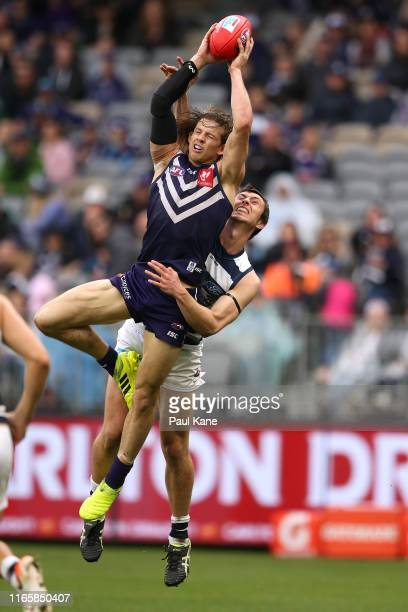 Nathan Fyfe of the Dockers marks the ball against Jack Henry of the Cats during the round 20 AFL match between the Fremantle Dockers and the Geelong...