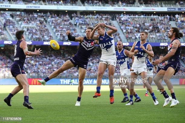 Nathan Fyfe of the Dockers palms the ball down to Andrew Brayshaw during the round one AFL match between the Fremantle Dockers and the North...