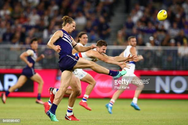 Nathan Fyfe of the Dockers passes the ball during the round five AFL match between the Fremantle Dockers and the Western Bulldogs at Optus Stadium on...