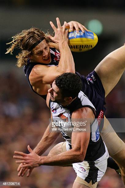 Nathan Fyfe of the Dockers takes an overhead mark during the round 16 AFL match between the Fremantle Dockers and the Carlton Blues at Domain Stadium...