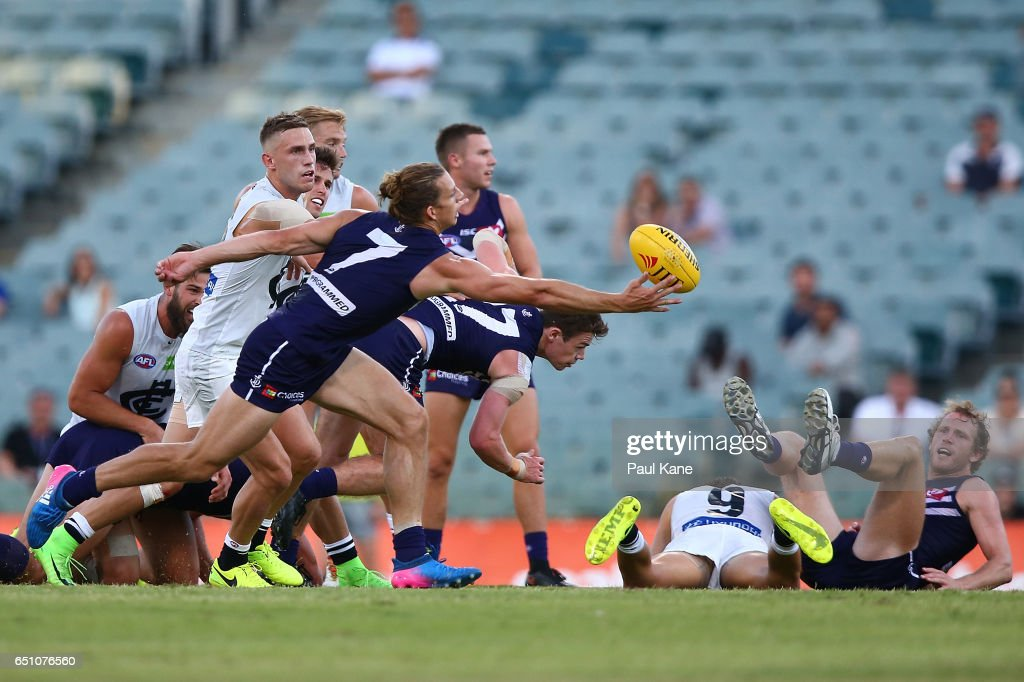 Nathan Fyfe of the Dockers wins a center possession during the JLT Community Series AFL match between the Fremantle Dockers and the Carlton Blues at Domain Stadium on March 10, 2017 in Perth, Australia.