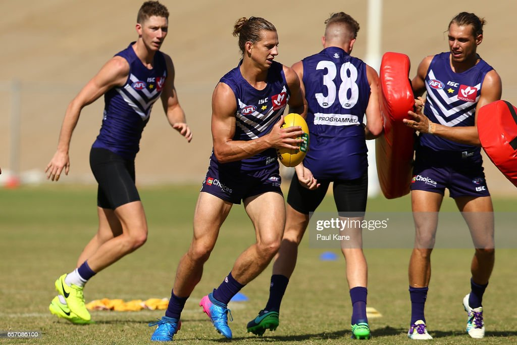 Nathan Fyfe of the Dockers works on a tackling drill during a Fremantle Dockers AFL training session at Victor George Kailis Oval on March 24, 2017 in Perth, Australia.