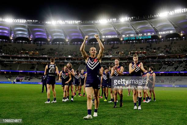 Nathan Fyfe of the Fremantle Dockers celebrates after the teams win during the round 11 AFL match between the Fremantle Dockers and the Hawthorn...