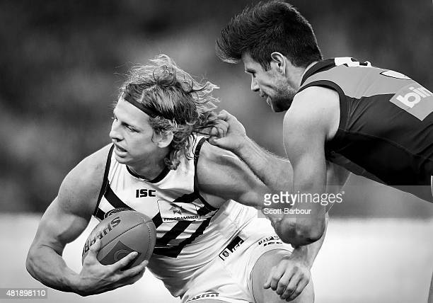 Nathan Fyfe of the Fremantle Dockers is tackled by Trent Cotchin of the Richmond Tigers during the round 17 AFL match between the Richmond Tigers and...