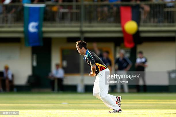 Nathan Gardiner bowls during the Imparja Cup match between the Black Caps and ACA at Trager Park on February 9 2014 in Alice Springs Australia