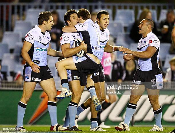 Nathan Gardner of the Sharks congratulates Trent Barrett after Barrett scored during the round 22 NRL match between the Cronulla Sharks and the...