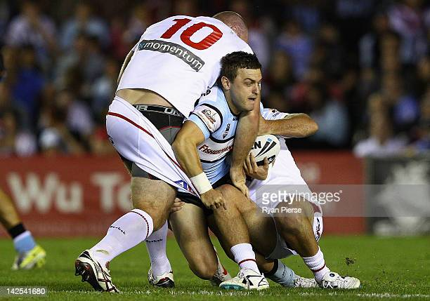 Nathan Gardner of the Sharks is tackled by Michael Weyman of the Dragons during the round six NRL match between the Cronulla Sharks and the St George...
