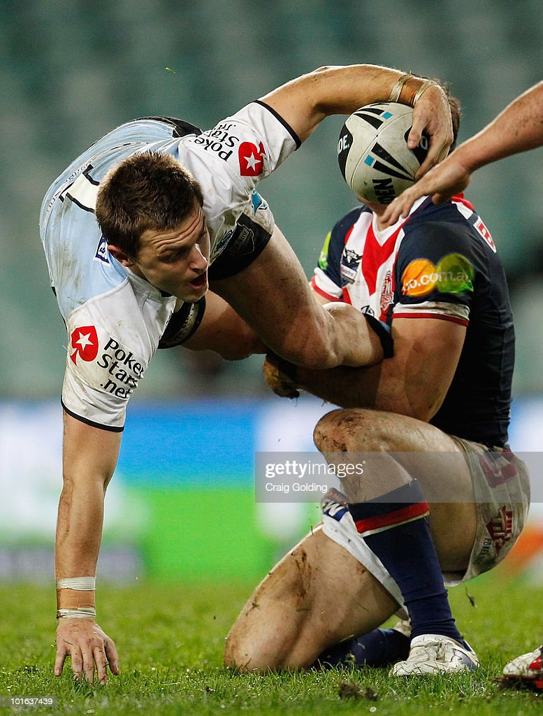 Nathan Gardner of the Sharks is tackled during the round 13 NRL match between the Sydney Roosters and the Cronulla Sharks at Sydney Football Stadium on June 5, 2010 in Sydney, Australia.