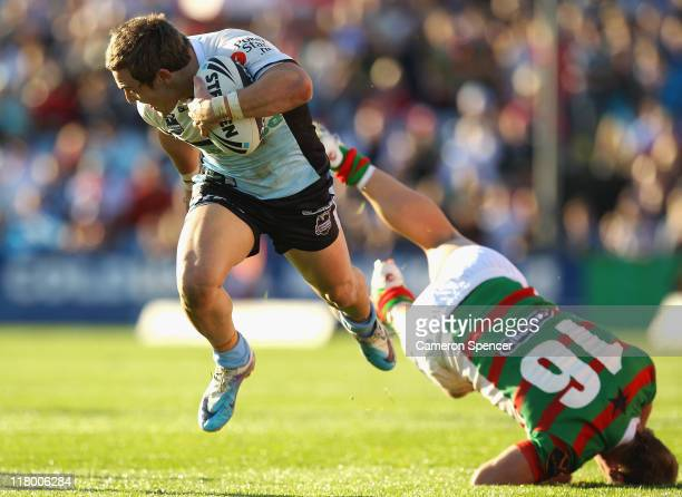 Nathan Gardner of the Sharks makes a break during the round 17 NRL match between the Cronulla Sharks and the South Sydney Rabbitohs at Toyota Stadium...