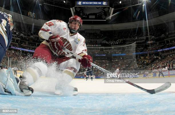 Nathan Gerbe of the Boston College Golden Eagles skates away after having a shot stopped by goaltender Jordan Pearce of the Notre Dame Fighting Irish...