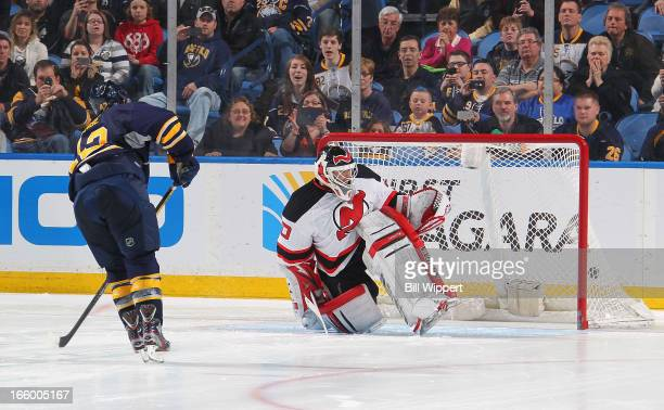 Nathan Gerbe of the Buffalo Sabres scores the game-winning shootout goal against Martin Brodeur of the New Jersey Devils on April 7, 2013 at the...