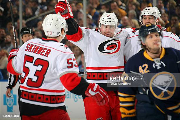 Nathan Gerbe of the Buffalo Sabres skates away as Jaroslav Spacek of the Carolina Hurricanes celebrates his first period goal with teammates Jeff...