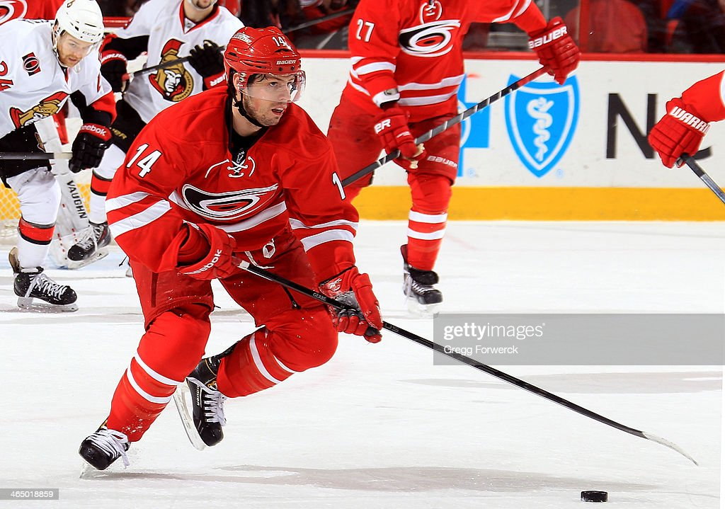 Nathan Gerbe #14 of the Carolina Hurricanes carries the puck during an NHL game against the Ottawa Senators at PNC Arena on January 25, 2014 in Raleigh, North Carolina.