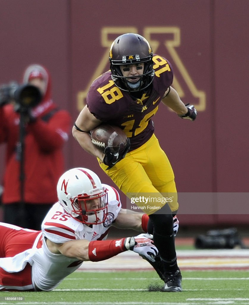 Nathan Gerry #25 of the Nebraska Cornhuskers attempts to tackle Derrick Engel #18 of the Minnesota Golden Gophers during the third quarter of the game on October 26, 2013 at TCF Bank Stadium in Minneapolis, Minnesota. The Golden Gophers defeated the Cornhuskers 34-23.