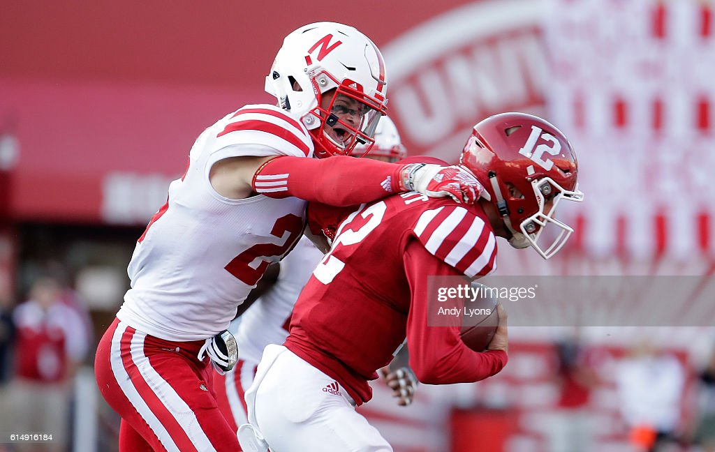 Nathan Gerry #25 of the Nebraska Cornhuskers tackles Zander Diamont #12 of the Indiana Hoosiers at Memorial Stadium on October 15, 2016 in Bloomington, Indiana.